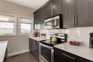 Photo 11: 312 QUARRY Villa SE in Calgary: Douglasdale/Glen Row/Townhouse for sale : MLS®# C4224154