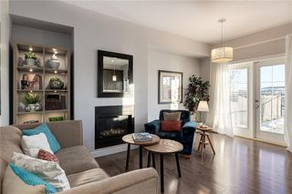 Photo 4: 312 QUARRY Villa SE in Calgary: Douglasdale/Glen Row/Townhouse for sale : MLS®# C4224154