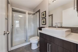 Photo 21: 312 QUARRY Villa SE in Calgary: Douglasdale/Glen Row/Townhouse for sale : MLS®# C4224154