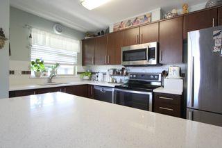 "Photo 2: 425 12238 224 Street in Maple Ridge: East Central Condo for sale in ""Urbano"" : MLS®# R2355981"