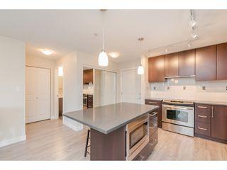 """Photo 9: 239 15850 26 Avenue in Surrey: Grandview Surrey Condo for sale in """"Axis at Morgan Crossing"""" (South Surrey White Rock)  : MLS®# R2358638"""