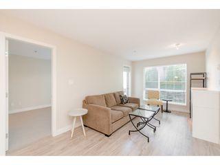 """Photo 4: 239 15850 26 Avenue in Surrey: Grandview Surrey Condo for sale in """"Axis at Morgan Crossing"""" (South Surrey White Rock)  : MLS®# R2358638"""