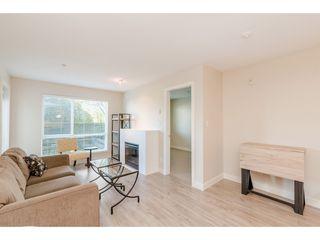 """Photo 3: 239 15850 26 Avenue in Surrey: Grandview Surrey Condo for sale in """"Axis at Morgan Crossing"""" (South Surrey White Rock)  : MLS®# R2358638"""
