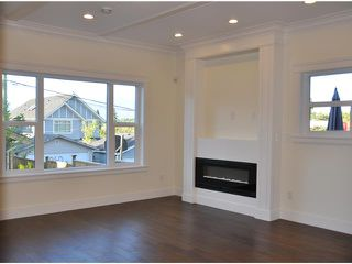 Photo 2: 1345 E 18TH Avenue in Vancouver: Knight 1/2 Duplex for sale (Vancouver East)  : MLS®# V1033848