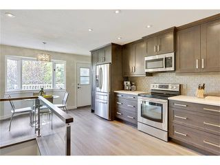 Photo 12: 816 COACH SIDE Crescent SW in Calgary: Coach Hill House for sale : MLS®# C4030748
