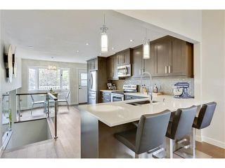 Photo 2: 816 COACH SIDE Crescent SW in Calgary: Coach Hill House for sale : MLS®# C4030748