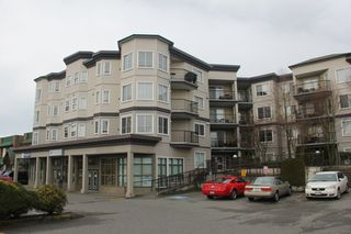 """Photo 1: 412 5759 GLOVER Road in Langley: Langley City Condo for sale in """"College Court"""" : MLS®# R2047493"""