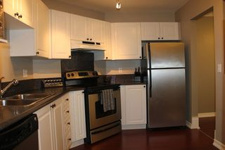 """Photo 4: 412 5759 GLOVER Road in Langley: Langley City Condo for sale in """"College Court"""" : MLS®# R2047493"""