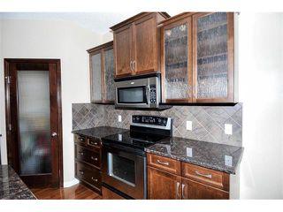 Photo 6: 172 ASPEN HILLS Close SW in Calgary: Aspen Woods House for sale : MLS®# C4102961