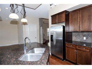 Photo 7: 172 ASPEN HILLS Close SW in Calgary: Aspen Woods House for sale : MLS®# C4102961