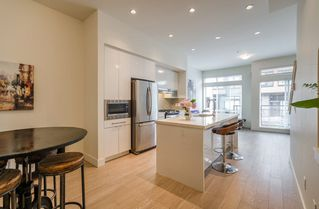 """Photo 1: 72 7811 209 Street in Langley: Willoughby Heights Townhouse for sale in """"Exchange"""" : MLS®# R2288165"""