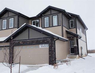 Main Photo: 8770 223 Street in Edmonton: Zone 58 House Half Duplex for sale : MLS®# E4139316