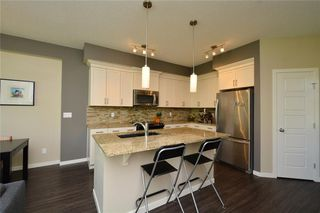 Photo 4: 255 SUNSET Point: Cochrane Row/Townhouse for sale : MLS®# C4224587