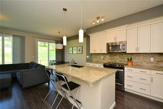 Photo 3: 255 SUNSET Point: Cochrane Row/Townhouse for sale : MLS®# C4224587