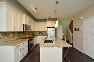 Photo 5: 255 SUNSET Point: Cochrane Row/Townhouse for sale : MLS®# C4224587