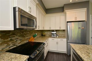 Photo 7: 255 SUNSET Point: Cochrane Row/Townhouse for sale : MLS®# C4224587