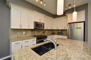 Photo 6: 255 SUNSET Point: Cochrane Row/Townhouse for sale : MLS®# C4224587