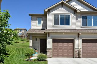 Photo 1: 255 SUNSET Point: Cochrane Row/Townhouse for sale : MLS®# C4224587