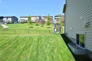 Photo 30: 255 SUNSET Point: Cochrane Row/Townhouse for sale : MLS®# C4224587