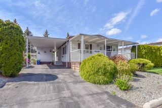 "Main Photo: 132 8234 134 Street in Surrey: Bear Creek Green Timbers Manufactured Home for sale in ""WESTWOOD ESTATE"" : MLS®# R2355383"