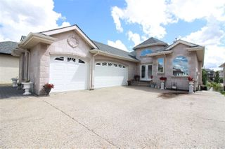 Photo 1: 348 OZERNA Road in Edmonton: Zone 28 House for sale : MLS®# E4163853