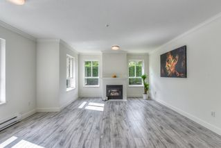 "Photo 3: 103 15885 84 Avenue in Surrey: Fleetwood Tynehead Condo for sale in ""Abbey Road"" : MLS®# R2429696"