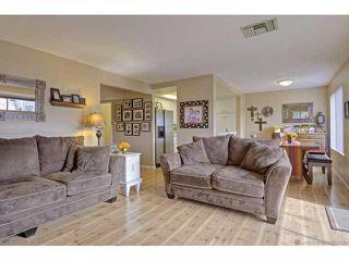 Photo 2: LA MESA Condo for sale : 2 bedrooms : 7780 Parkway Drive #601