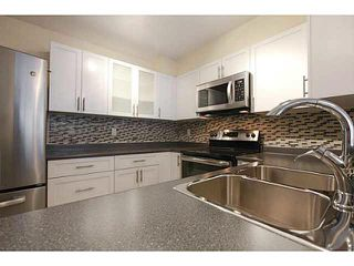 "Photo 3: 201 2340 HAWTHORNE Avenue in Port Coquitlam: Central Pt Coquitlam Condo for sale in ""BARRINGTON PLACE"" : MLS®# V1119321"