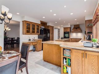 Photo 11: 308 COACH GROVE Place SW in Calgary: Coach Hill House for sale : MLS®# C4064754