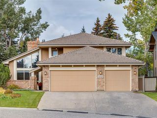 Photo 2: 308 COACH GROVE Place SW in Calgary: Coach Hill House for sale : MLS®# C4064754
