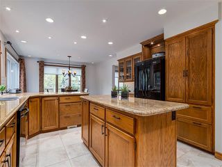 Photo 8: 308 COACH GROVE Place SW in Calgary: Coach Hill House for sale : MLS®# C4064754