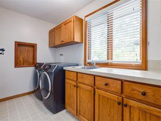 Photo 32: 308 COACH GROVE Place SW in Calgary: Coach Hill House for sale : MLS®# C4064754