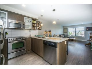 "Photo 3: 301 19936 56 Avenue in Langley: Langley City Condo for sale in ""Bearing Point"" : MLS®# R2103266"