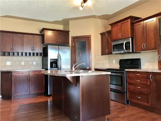 Photo 6: 1139 PRAIRIE SPRINGS Hill(S) SW: Airdrie House for sale : MLS®# C4132965