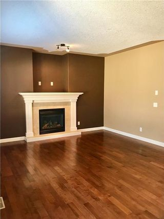 Photo 8: 1139 PRAIRIE SPRINGS Hill(S) SW: Airdrie House for sale : MLS®# C4132965