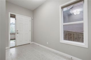 Photo 2: 74 Evansfield Park NW in Calgary: Evanston House for sale : MLS®# C4187281