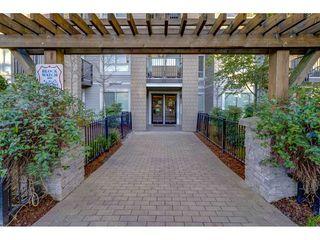 "Photo 1: 107 6688 120 Street in Surrey: West Newton Condo for sale in ""Salus"" : MLS®# R2312472"