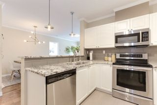 "Photo 8: 107 5555 13A Avenue in Delta: Cliff Drive Condo for sale in ""WINDSOR WOODS - THE CAMPTON"" (Tsawwassen)  : MLS®# R2361426"