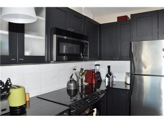 "Photo 6: 702 7225 ACORN Avenue in Burnaby: Highgate Condo for sale in ""AXIS"" (Burnaby South)  : MLS®# V1087439"
