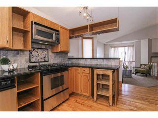Photo 10: 25 HARVEST GLEN Court NE in Calgary: Harvest Hills House for sale : MLS®# C3650291