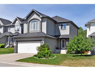 Photo 1: 42 ARBOUR BUTTE Way NW in Calgary: Arbour Lake House for sale : MLS®# C4017385