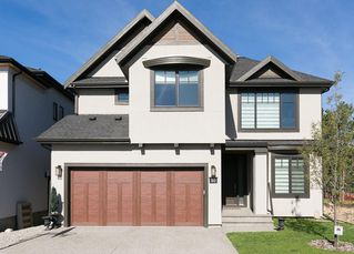 Photo 1: 30 ASPEN RIDGE Park SW in Calgary: Aspen Woods House for sale : MLS®# C4119944