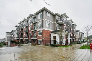 "Photo 1: 103 6480 195A Street in Surrey: Clayton Condo for sale in ""Salix"" (Cloverdale)  : MLS®# R2260850"
