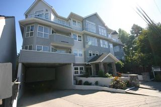 "Main Photo: 102 1630 154 Street in Surrey: King George Corridor Condo for sale in ""CARLTON COURT"" (South Surrey White Rock)  : MLS®# R2308076"