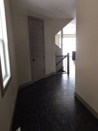 Photo 2: 3420 PARKER Loop in Edmonton: Zone 55 House for sale : MLS®# E4146198