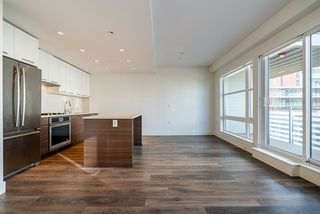 "Photo 2: 509 3488 SAWMILL Crescent in Vancouver: South Marine Condo for sale in ""3 TOWN CENTRE"" (Vancouver East)  : MLS®# R2423057"