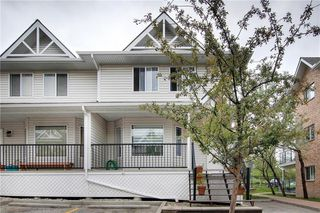 Main Photo: 413 950 ARBOUR LAKE Road NW in Calgary: Arbour Lake Row/Townhouse for sale : MLS®# C4305659