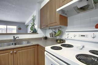 Photo 5: 8216 304 Mackenzie Way SW: Airdrie Apartment for sale : MLS®# A1049614