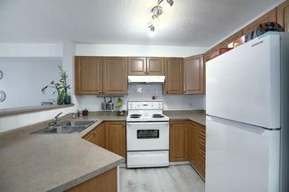 Photo 3: 8216 304 Mackenzie Way SW: Airdrie Apartment for sale : MLS®# A1049614