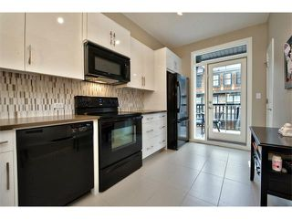 Photo 4: 312 ASCOT Circle SW in Calgary: Aspen Woods House for sale : MLS®# C4003191